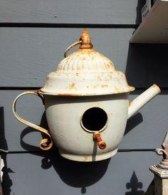 Cute bird house made from vintage tea pot
