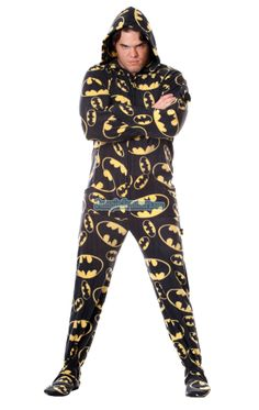 Official BATMAN Footed Hooded Pajamas! Loaded with extras featuring: Hoodies, thumb holes, logo zipper pull, front kangaroo pockets and even a left shoulder pocket perfect for your IPhone ready to rock out when you are. TM & © DC Comics.  (s12) $64.99