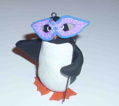 masked penguin made from polymer clay