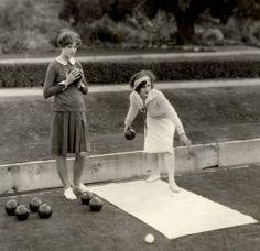 Myrna Loy, lawn bowling with friend.