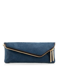 The Debutante Slim Asymmetrical Haircalf Clutch is a sleek and stylish luxury handbag for the girl on the go. Featuring haircalf panels trimmed with smooth leather and finished with custom Henri Bendel hardware, this designer handbag features a removable shoulder chain so you can carry it any way your heart desires.