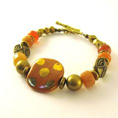 Orange With Gold Dots Kazuri Bead Bracelet by CinLynnBoutique, $23.00