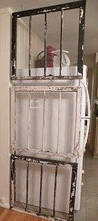 Love me some old vintage windows! Old window divider! I can see pretty shabby chic vintage papers, sheet music, lace, ribbon, and elements on these! I am liking this idea of old windows as room dividers!