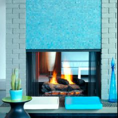 vibrant aqua blue mosaic tile fireplace