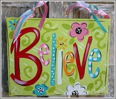 "This is a hand-painted stretched canvas that is 11"" x 14"". Ready to hang with pretty ribbons $40.00"