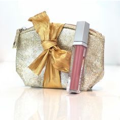 """Holiday Lip Kit $29  This festive sparkling beauty pouch comes with a divalishious lip plumping gloss. Bag size 6.5""""x3.5""""x2.75""""  lip gloss 0.20 oz Limited edition."""