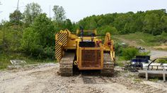 Construction equipment shipping companies, equipment transportation services, heavy equipment haulers