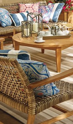 """With a breathable open weave, our Isola Seating Collection is the perfect fit for arid and coastal climates alike. Generously proportioned seating features solid premium teak frames wrapped in 3/4""""-wide bands of driftwood-hued, all-weather wicker, widely woven for visual and tangible lightness."""
