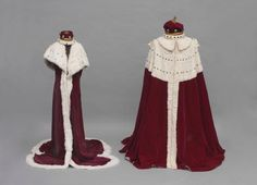 The Lord Woodbridge's Robe and Coronet. Comprising a baron's coronet, crimson silk velvet and ermine robe, two pairs of silk hose, together with Lady Woodbridge's coronet and crimson silk velvet and ermine robe, all contained in the japanned tin with brass plaque engraved Lord Woodbridge.