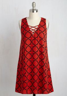 Good style is all about a balance of fashion and comfort - thankfully, this red dress offers you both! Crafted with a crisscrossing detail at the neckline and bold black pattern, this swingy shift will win you over with its elegant equilibrium.