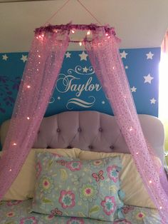 Little girl's bed. DIY canopy. Stencils & decals.