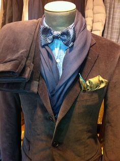 Great look - denim shirt and a bow tie - the rest is icing on the cake.