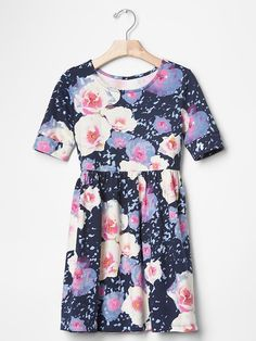 Shirred babydoll dress GAP -     100% Cotton, Soft jersey; Short sleeves with banded cuffs; Round neckline; Shirring at waist seam.