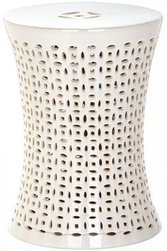 A simple white garden stool makes the perfect little side table or extra seat for your friends. HomeDecorators.com