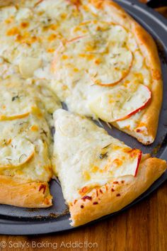 My favorite pizza! Homemade pizza crust piled with creamy gorgonzola cheese, caramelized apples, and rosemary. Sweet, salty, perfect.