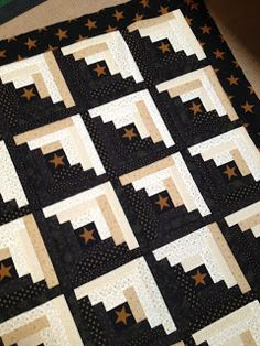 """""""Little Black Cabin"""" quilt from My Red Door Designs. (No pattern after jump, I wouldn't bother clicking. This is just a log cabin quilt with a fussy-cut star as the center block.)"""