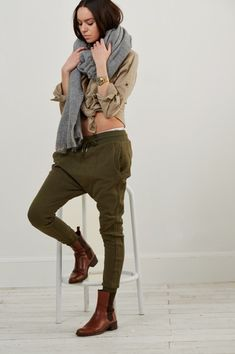 If you're a jeans-and-a-tee kind of gal, you'll like the simple combo of a camel dress shirt and olive green running pants. Brown leather chelsea boots will add elegance to an otherwise simple look.  Shop this look for $108:  http://lookastic.com/women/looks/shawl-watch-dress-shirt-sweatpants-chelsea-boots/7478  — Grey Shawl  — Gold Watch  — Tan Dress Shirt  — Olive Sweatpants  — Brown Leather Chelsea Boots