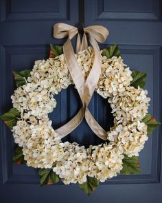 A wonderful Hydrangea Door Wreath arrangement. The wreath is handcrafted on a grapevine base with artificial cream hydrangea flowers and