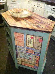old tv unit upcycled to a diy kitchen island . Used diy chalk paint , diy mod podge and added casters :)