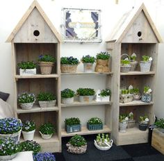 Birdhouse-style shelving made from recycled wood add a simple, decorative touch to this display Reclaimed Furniture, Primitive Furniture, Cool Furniture, Easy Garden, Lawn And Garden, Craft Show Displays, Display Ideas, Birdhouse Designs, Bird House Kits