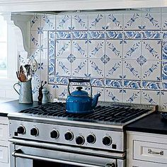 I'm starting to LOVE white or off-white kitchens with pretty porcelain tile!  Love it.