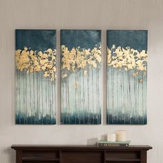 Midnight Forest is a triptych set will add style and sophistication to your living room. The set incorporates a beautiful teal color and hand applied gold foiling for added dimension.