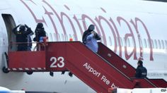 The co-pilot of an Ethiopian Airlines flight from Addis Ababa to Rome has been detained after hijacking his plane and forcing it to land in Geneva. (Picture - Police evacuate passengers off the Ethiopian airlines plane.)