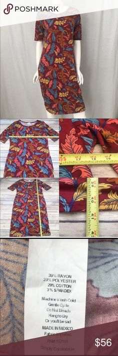 🌴 Large LuLaRoe Maroon Feather Print Julia Dress Measurements are in photos. Normal wash wear, no flaws. C1  I do not comment to my buyers after purchases, due to their privacy. If you would like any reassurance after your purchase that I did receive your order, please feel free to comment on the listing and I will promptly respond.   I ship everyday and I always package safely. Thank you for shopping my closet! LuLaRoe Dresses Midi