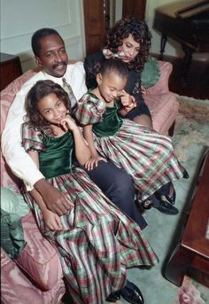 Matthew, Tina, Beyonce, and Solange Knowles. Christmas, 1990.