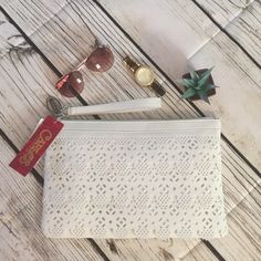 Large Tiered-Lace White Clutch Tiered,lace like perforated design. Perfect for any outfit. -Faux leather, 13*8*1, zipper top in closure, interior- floral print lining Carlos Santana Bags Clutches & Wristlets