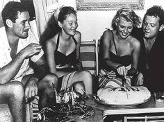 Errol Flynn, Nora Eddington, Rita Hayworth y Orson Welles