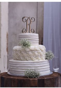 A single letter unfinished cake topper looks fabulous on the 3-tier cake.