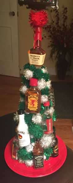 Nip Tree! Found this idea for a drunken Yankee swap or secret Santa. Styrofoam cone, hot glue, and Pom poms from the craft store and about 13 assorted nip bottles. Merry Christmas!