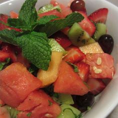 This fruit salad uses all the flavours of summer by mixing watermelon, strawberries, peaches, nectarines, pears and grapes in a lemon, honey and mint dressing. HELLO SUMMER!
