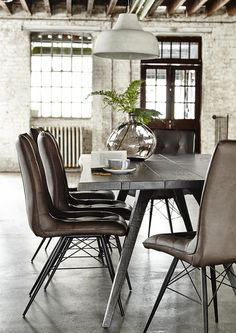 Looking for the perfect dining chair? You've found it with our stylish and versatile Hix Chair. Featuring angled metal legs and a cushioned leather-effect seat, it has a cosy yet industrial vibe that looks great with our Vega Dining Table. Available in brown or grey.