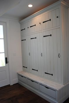 Mudroom Cabinet. Custom mudroom cubby cabinet with strap hardware by Acorn. Bench seat is made of honed Imperial Danby. #Mudroom #MudroomCabinet #Cabinet Stacye Love Construction & Design, LLC