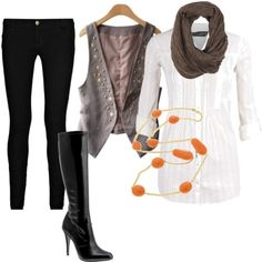 Slim jeans or leggings, big overshirt, waistcoat and scarf. Looks on trend whatever your age ( and disguises bumps !)
