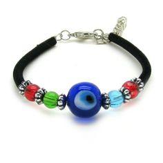 "Navy Blue Lampwork Glass Evil Eye Velvet Cord Bracelet Sparkly Bride. $9.99. Evil Eye glass bead charms; green and blue glass accents; Velvet cord bracelet; Size 6.75"" adjustable to 7.5"" with extender; Silver beaded links. Save 50% Off!"