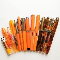 Pen collection in shades of orange/tortoise