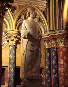 Statue of King Louis IX of France who commissioned the building of Sainte-Chapelle in Paris in 1239.