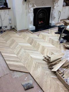 In progress of laying a prime grade oak parquet Chevron floor.