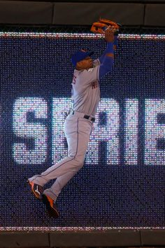 WORLD SERIES GAME 2 - The Mets' Yoenis Cespedes catches a ball at the wall in the sixth inning of Game 2 of the World Series at Kauffman Stadium on Oct. 28, 2015. (Photo by Christian Petersen/Getty Images)