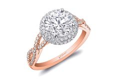 Diamoned-twisted rose gold engagement ring by Coast Diamond