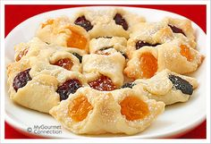 Kiffles (kiflis) are traditional Hungarian cream cheese pastry cookies with assorted fruit and nut fillings like apricot, cherry, almond, and poppyseed. Hungarian Kiffles Recipe, Hungarian Recipes, No Bake Desserts, Delicious Desserts, Dessert Recipes, Yummy Food, Hungarian Cookies, Eat Dessert First, How Sweet Eats