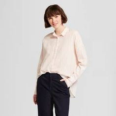 Let your unique style shine in this Long-Sleeve Oversized Button-Down Shirt from A New Day™. This peach button down features metallic fibers running through for a striking touch, and it pairs perfectly with any bottoms. Whether you're keeping your look sophisticated with chinos or casual with jeans, this blouse will make an easy addition to your wardrobe.