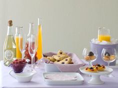 Brunch is a grown-up way to relax tradition and mix delicious foods that might not typically be served together. Start by setting up a buffet in your most light-filled room. Pick a favorite color scheme, like lilac, and lay out a pretty linen tablecloth, napkins, white dishes and juices, like orange and cranberry.