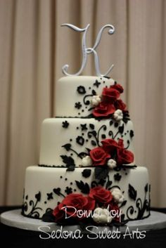 Try with blue scrolling and flowers your choice, I would do four their and then have you buy a cake topper, probably not a letter, unless you like that but I'm not a huge fan