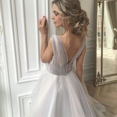 So laconically simple, gentle and airy. With small buttons on the back of the corset and an intriguing cutout. You will be delighted, as a charming gray with shades of lavender and ivorywill play under the rays of the sun. In truth, this is our novelty