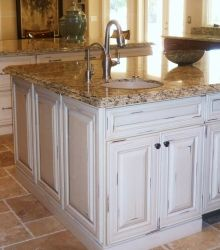 I like that shabby chic look on the cabinets and the floor tile too!