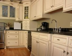 Antique White Cabinets With My Turquoise Appliances And Black Granite?